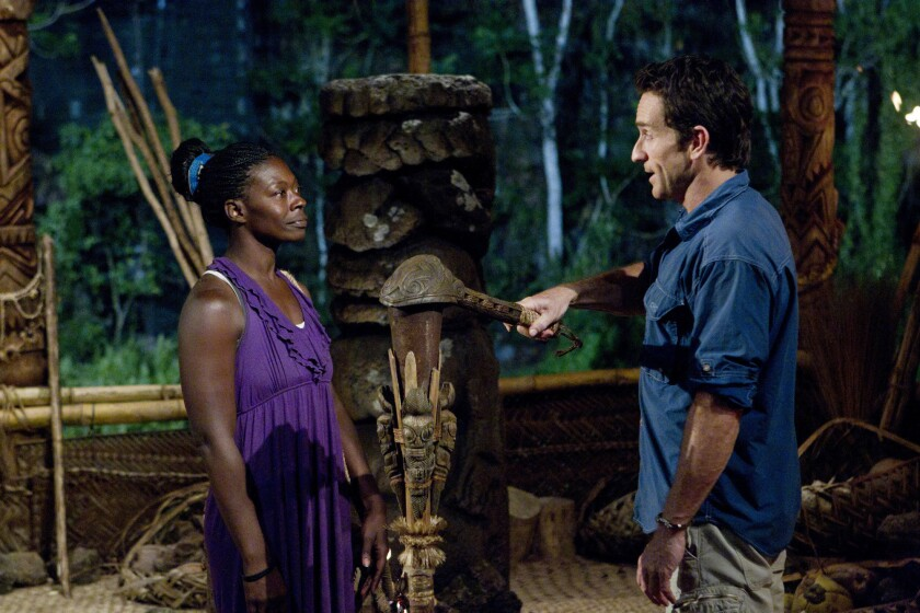 """Stacey Powell has her torch snuffed out by Jeff Probst after being voted out of her tribe during the fourth episode of """"Survivor: South Pacific"""""""