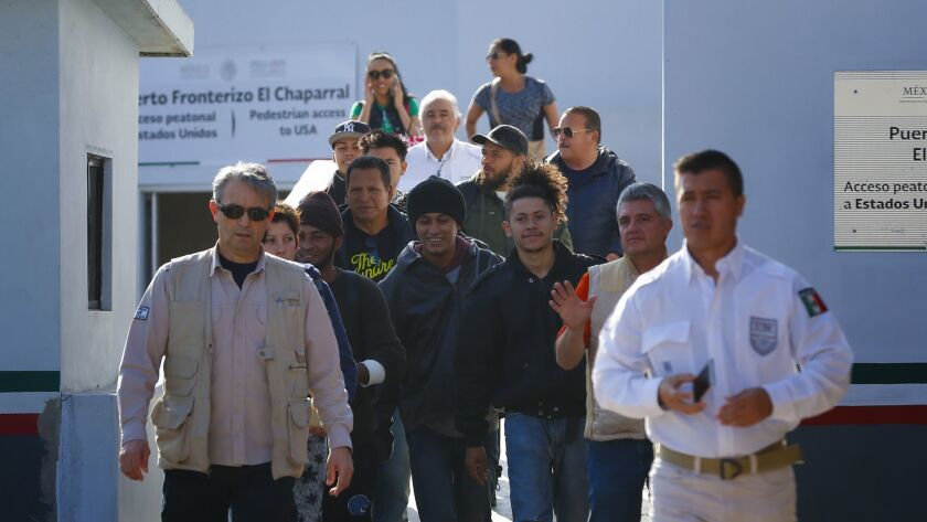 A group of migrants that were under CBP custody in San Diego for processing during their initial request for asylum in the U.S. are returned to Mexico at El Chaparral port of entry in Mexico.
