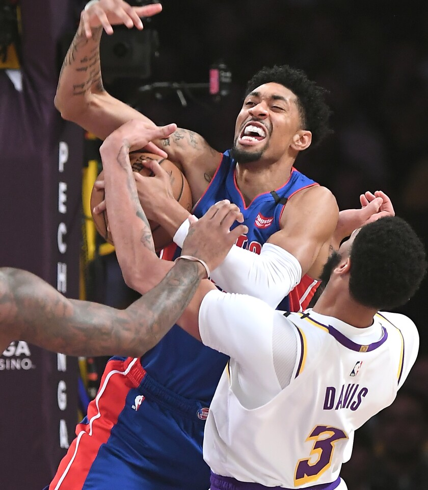 LOS ANGELES, CALIFORNIA JANUARY 5, 2020-Lakers Anthony Bradley blocks the shot of Pistons Christian Wood in the 1st quarter at the Staples Center Sunday. (Wally Skalij/Los Angerles Times)