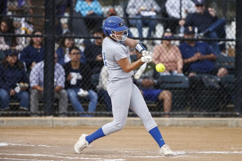 Rancho Bernardo's Heather Menzer (11) hits an RBI single in the fourth inning against Bonita Vista.