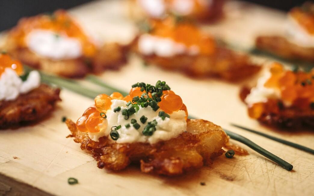 Potato pancakes with fresh whipped lemon cream and salmon eggs