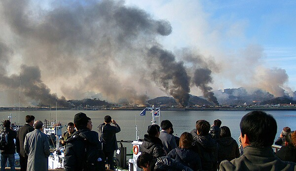 Plumes of smoke rise from Yeonpyeong island in the disputed waters of the Yellow Sea. North Korea fired artillery shells onto the South Korean island, killing two people, setting homes ablaze and triggering an exchange of fire as the South's military went on top alert.