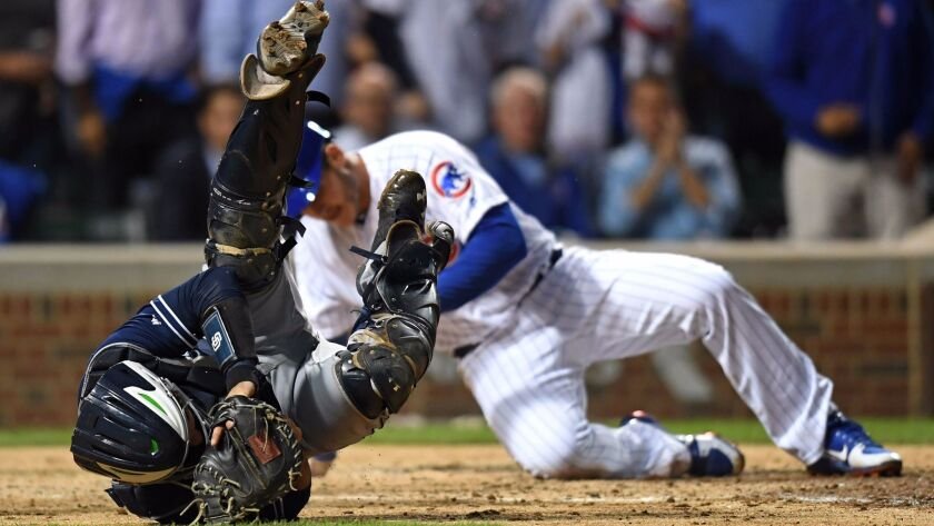 Jun 19, 2017; Chicago, IL, USA; San Diego Padres catcher Austin Hedges tumbles after tagging out Chi