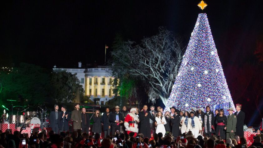 President Obama sings Christmas carols on stage beside performers and family members Dec. 1 at the 94th annual National Christmas Tree Lighting in Washington.