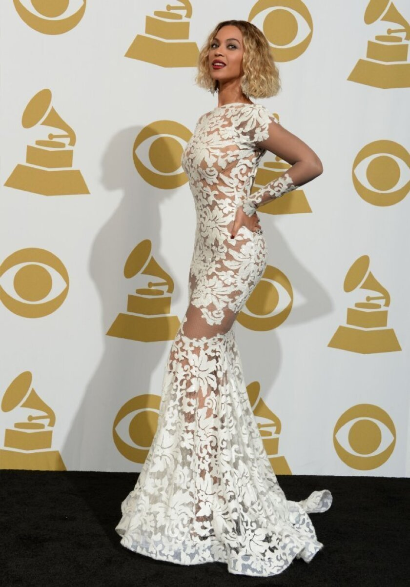 Beyonce wears a dress by designer Michael Costello at the 56th Grammy Awards at Staples Center in Los Angeles.