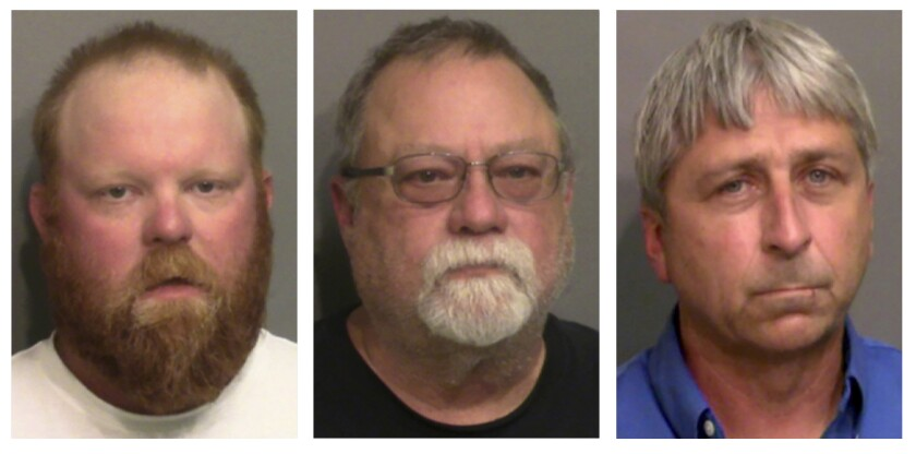 """FILE - This combo of booking photos provided by the Glynn County, Ga., Detention Center, shows from left, Travis McMichael, his father Gregory McMichael, and William """"Roddie"""" Bryan Jr. A Georgia judge says he won't allow attorneys for the men charged with killing Ahmaud Arbery to use evidence of the slain Black man's troubled past when they stand trial for murder. Superior Court Judge Timothy Walmsley said in a written order that the victim's character isn't relevant or admissible in a murder case. Father and son Gregory and Travis McMichael and their neighbor William """"Roddie"""" Bryan face trial this fall in the February 2020 slaying. (Glynn County Detention Center via AP, File)"""