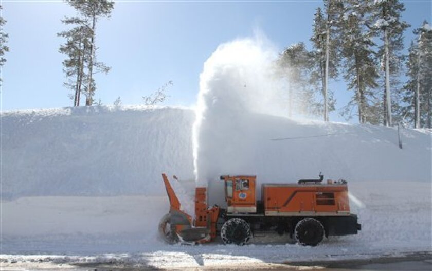 In this photo taken March 28, a California Department of Transportation snow remover clears a road near Soda Springs, Calif. Near record snow in the Sierra limited travel and eased concerns about water supplies statewide.