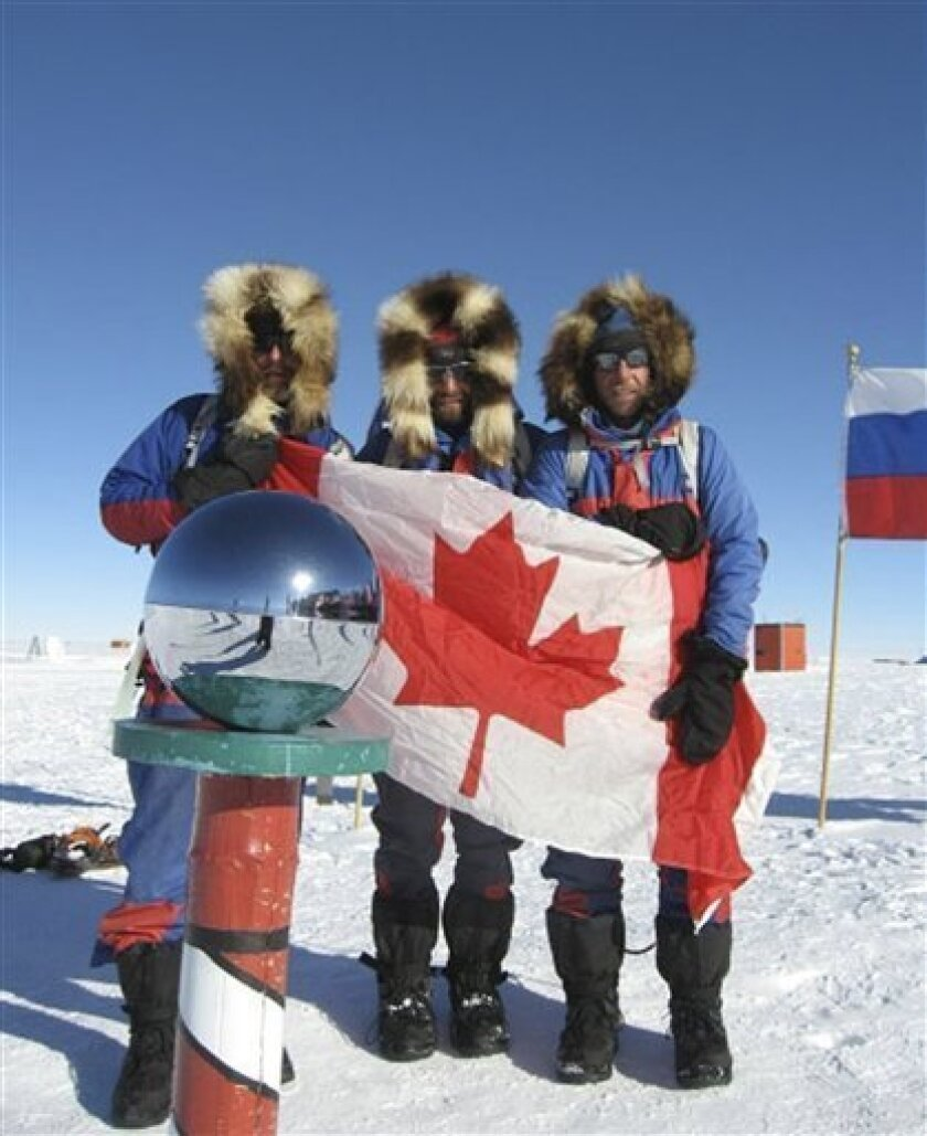 In this photo released from the South Pole Quest, Canadian adventurers from left, Ray Zahab of Chelsea, Quebec, Kevin Vallely of North Vancouver and Richard Weber of Alcove, Quebec are pictured at the South Pole Thursday, Jan. 9, 2009. The trio of Canadian adventurers claim to have set a new record
