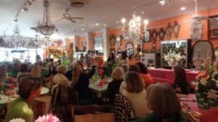 Volunteers and beneficiaries come together to distribute funds and celebrate Ark Antiques' 10th anniversary on st. Patrick's Day. Courtesy