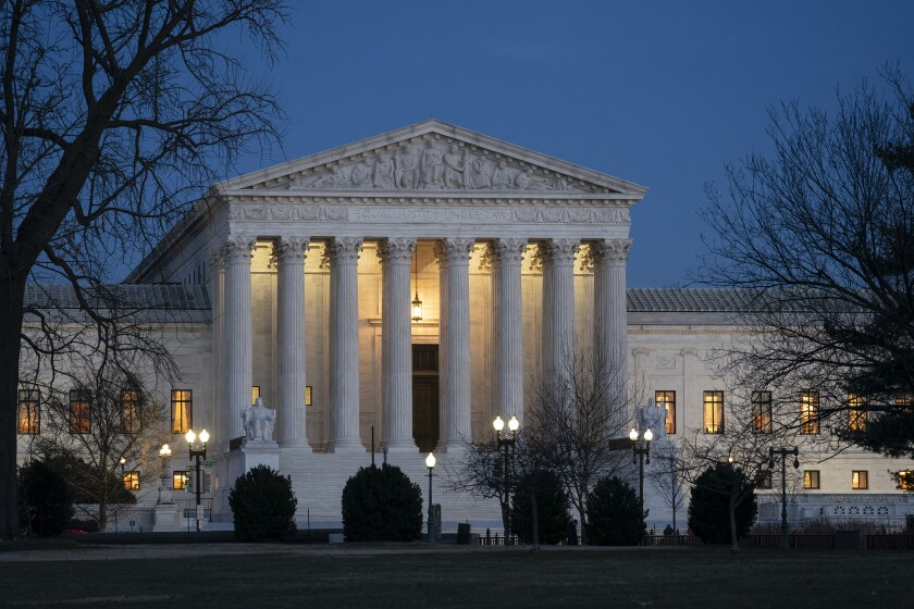FILE - In this Jan. 22, 2020, file photo, night falls on the Supreme Court in Washington.