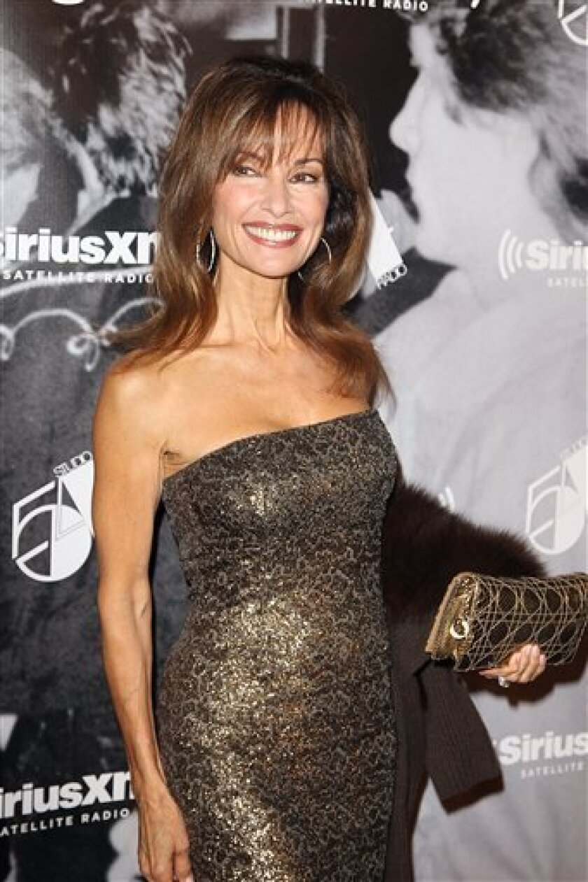 """FILE - In this Tuesday, Oct. 18, 2011 photo, actress Susan Lucci attends the SiriusXM reopening of Studio 54 for """"One Night Only"""" at Studio 54 in New York City. The """"All My Children"""" veteran is returning to the world of soap operas. But this time, the stories will be real. The Investigation Discovery network says Lucci will host and narrate """"Deadly Affairs."""" It said Thursday, Jan. 12, 2012 the new series will explore real-life cases of romance gone wrong and the crimes of passion that resulted. (AP Photo/Donald Traill)"""