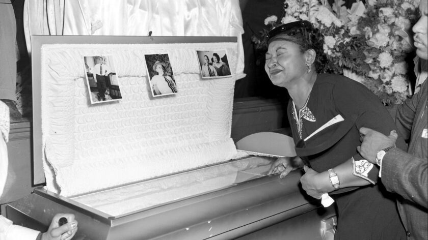 FILE- In this Sept. 6, 1955 file photo, Mamie Till Mobley weeps at her son's funeral in Chicago. T