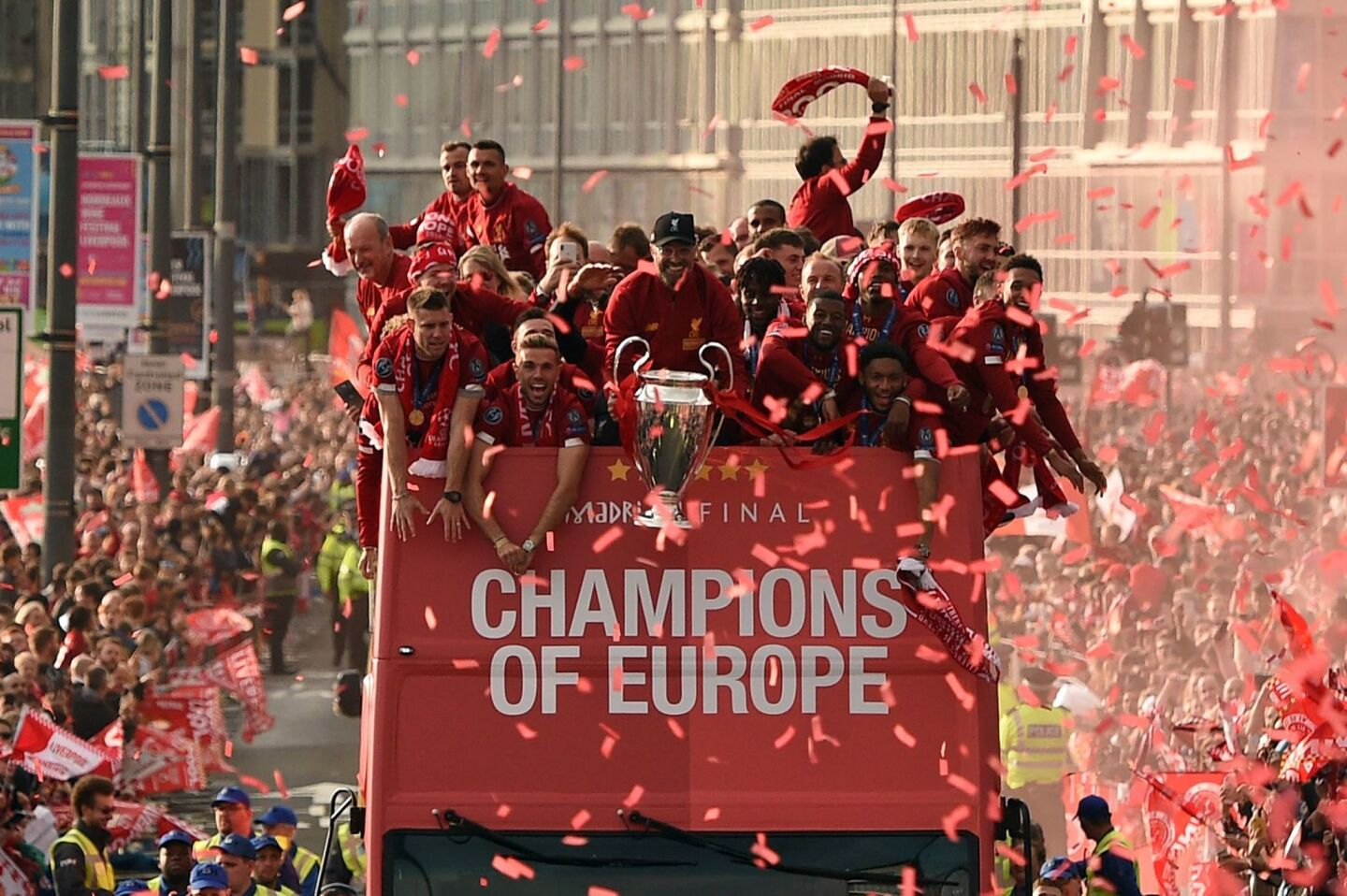 Liverpool's German manager Jurgen Klopp (C) holds the European Champion Clubs' Cup trophy during an open-top bus parade around Liverpool, north-west England on June 2, 2019, after winning the UEFA Champions League final football match between Liverpool and Tottenham. - Liverpool's celebrations stretched long into the night after they became six-time European champions with goals from Mohamed Salah and Divock Origi to beat Tottenham -- and the party was set to move to England on Sunday where tens of thousands of fans awaited the team's return. The 2-0 win in the sweltering Metropolitano Stadium delivered a first trophy in seven years for Liverpool, and -- finally -- a first win in seven finals for coach Jurgen Klopp. (Photo by Oli SCARFF / AFP)OLI SCARFF/AFP/Getty Images ** OUTS - ELSENT, FPG, CM - OUTS * NM, PH, VA if sourced by CT, LA or MoD **