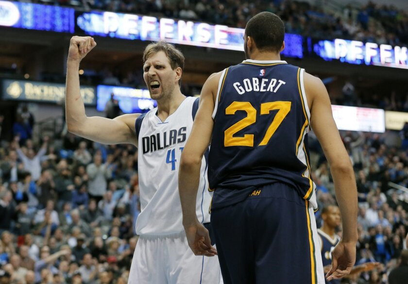 Dallas Mavericks' Dirk Nowitzki (41) of Germany celebrates a basket in front of Utah Jazz's Rudy Gobert (27) of France  in the second half of an NBA basketball game, Tuesday, Feb. 9, 2016, in Dallas. The Jazz won in overtime 121-119. (AP Photo/Tony Gutierrez)
