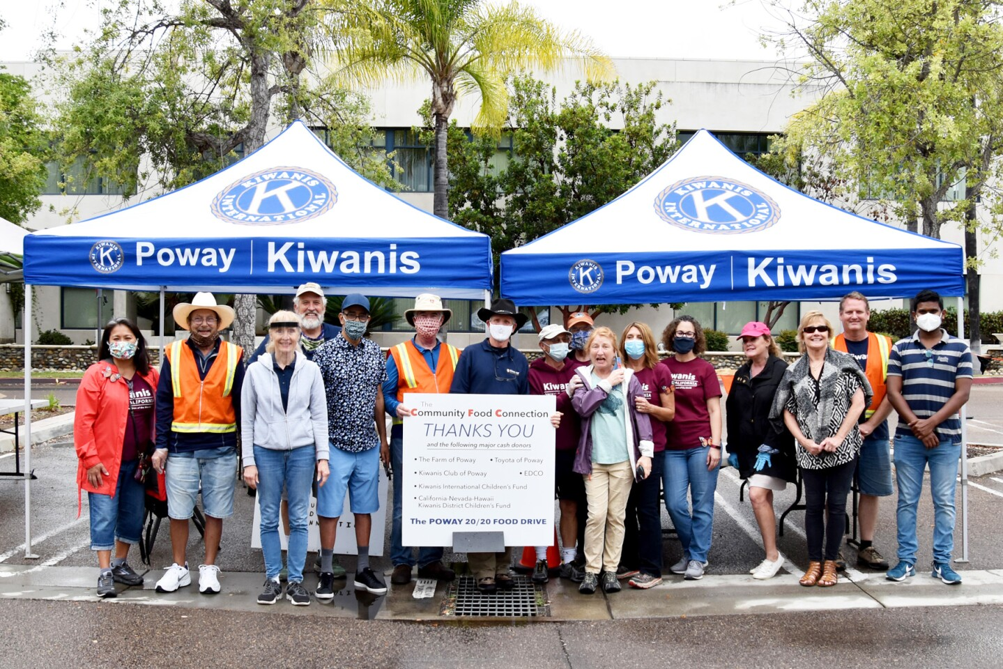Poway Kiwanis members at the food drive. The members worked in shifts throughout the morning to gather donations.