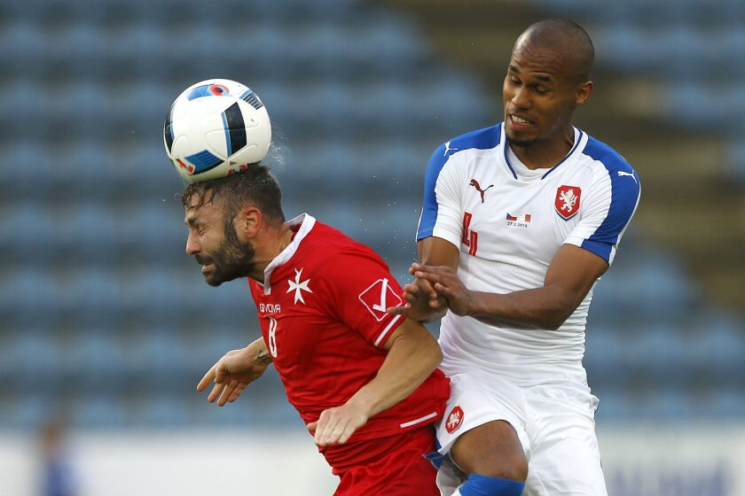 Paul Fennech from Malta, left, and Theodor Gebre Selassie of Czech Republic challenge for the ball during a friendly soccer match between Czech Republic and Malta in Kufstein, Austria, Friday, May 27, 2016. The Czech Republic National Football Team is in Austria for a training camp in preparation f