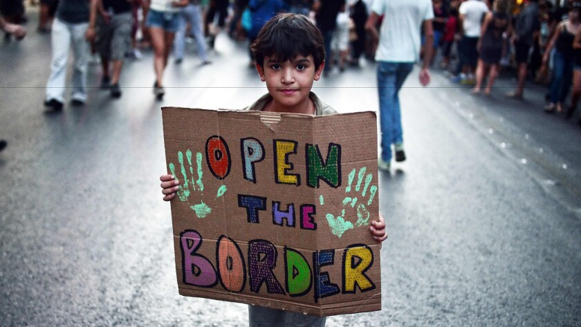 A child shares his sentiments during a demonstration in Athens in August to support refugees and migrants.