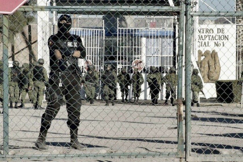 Soldiers guard the entry to the facility in Durango after the uprising. Mexico's prisons have become increasingly crowded and dangerous.