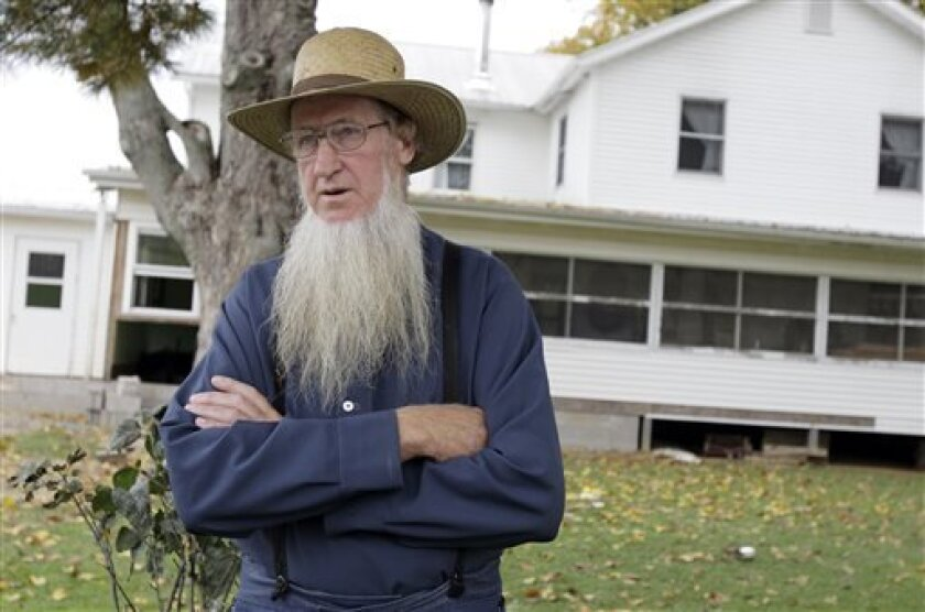 FILE - In this Monday, Oct. 10, 2011 file photo, Sam Mullet stands in front of his Bergholz, Ohio, home. Attorneys for a group of Amish men and women found guilty of hate crimes for cutting the hair and beards of fellow members of their faith in eastern Ohio are arguing that the group's conviction, sentencing and imprisonment in separate facilities across the country violates their constitutional rights and amounts to cruel and unusual punishment, according to recent court filings. The Amish gro
