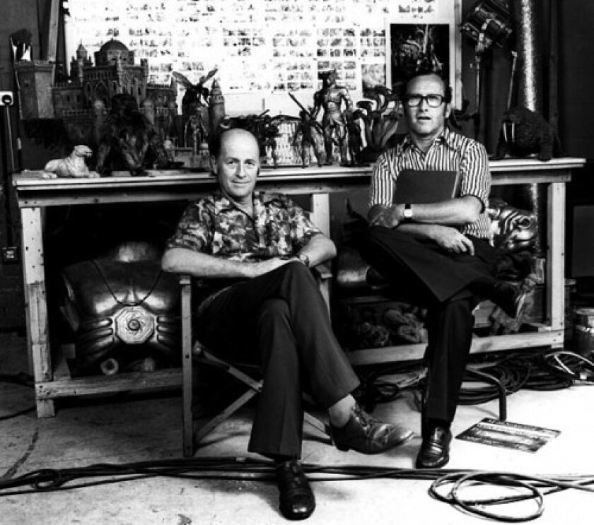 """Ray Harryhausen, left, and Charles H. Schneer sit in front of several of Ray's designs about the time of the release of """"Sinbad and the Eye of the Tiger"""" in 1977. Film critic and historian Leonard Maltin said, """"Ray is an artist, and creative people like that really need someone to facilitate the business end of things so they can focus on what they do best. That's how their partnership thrived."""""""