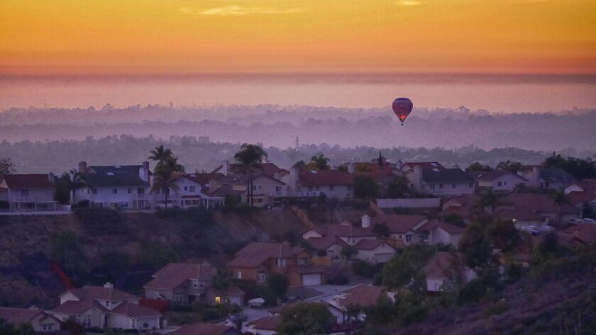 SAN DIEGO, CA 11/04/2018: A hot air balloon flies above homes in Rancho Penasquitos a short time aft