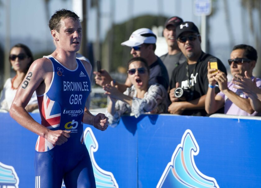 Alistair Brownlee, of Great Britain, is cheered on by the crowd dueing the run segment of the Omegawave World Triathlon San Diego. Brownlee would go on to win the event.