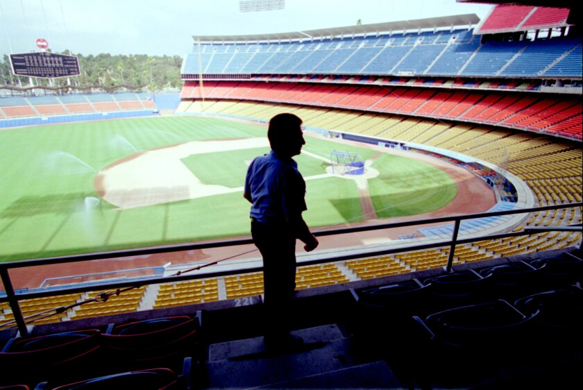 Security guard Oscar Garcia patrols an empty Dodger Stadium on Aug. 12, 1994, after the game between the Dodgers and Cubs was canceled because of the players' strike.