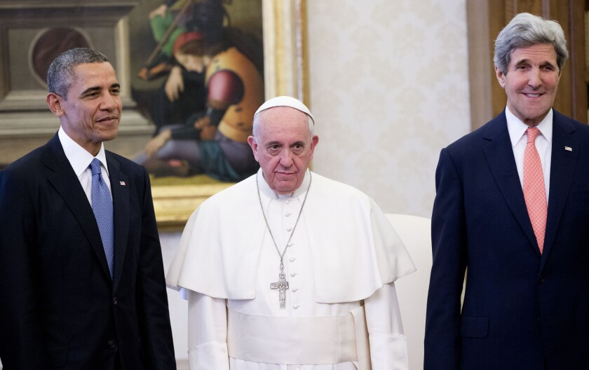 Pope Francis poses with President Obama and Secretary of State John F. Kerry at the Vatican.