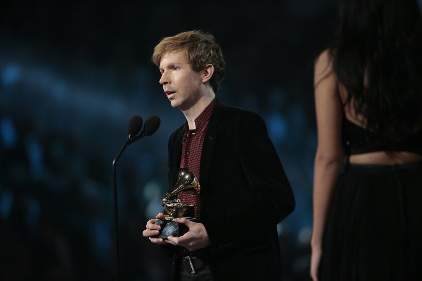 """Beck accepts the Album of the Year Grammy for """"Morning Phase"""" during The 57th Annual Grammy Awards."""