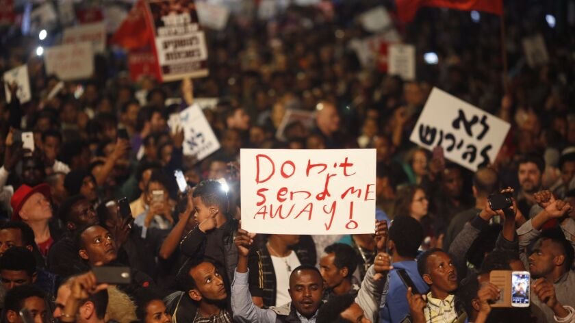 FILE - In this Feb. 24, 2018 file photo, asylum seekers protest against deportation in Tel Aviv, Isr