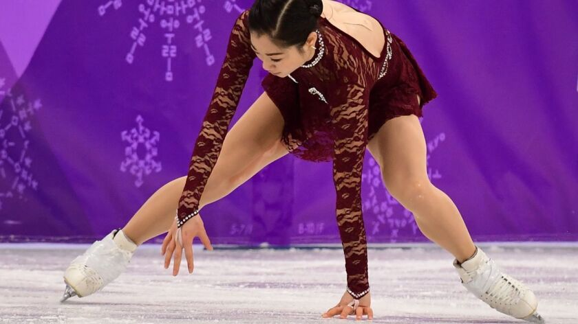 Mirai Nagasu falls as she competes in the women's single skating short program of the figure skating event during the Pyeongchang 2018 Winter Olympic Games on Wednesday.