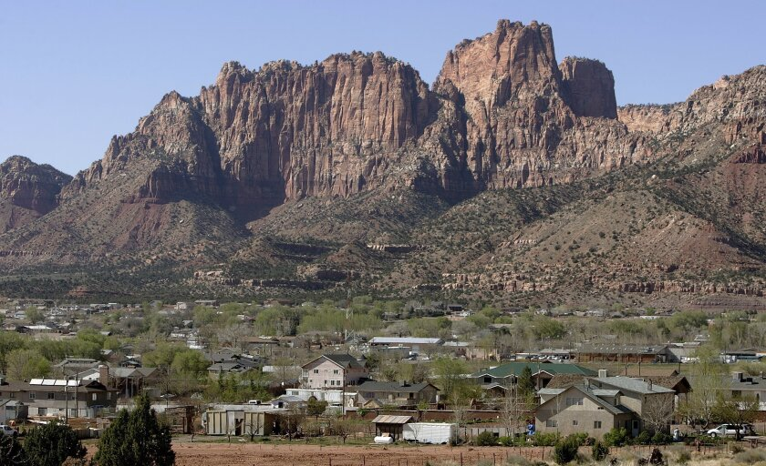 FILE - In this April 20, 2006, file photo, Hildale, Utah, sits at the base of Red Rock Cliff mountains with its sister city, Colorado City, Ariz., in the foreground. Utah's liquor commission has approved a winemaking license for a new winery in the town of Hildale, home to a polygamous sect. (AP Ph