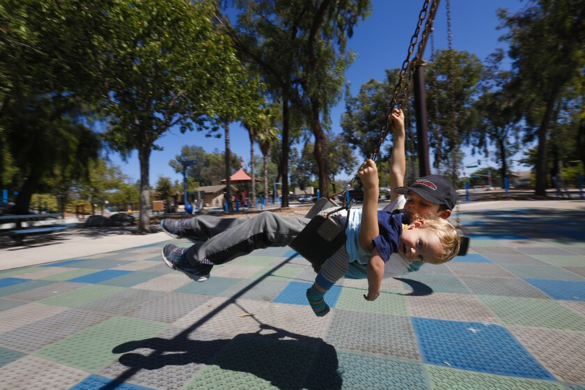 Jayden, 9 (preferred to not use last name) took advantage of the first day of reopening the children's playground.