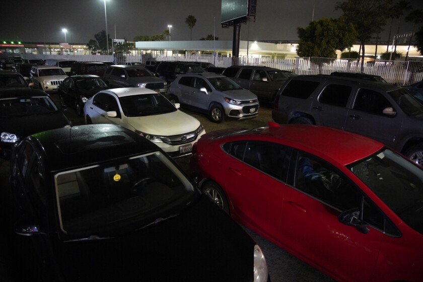 Hundreds of cars wait in line for the Otay border crossing border to open.