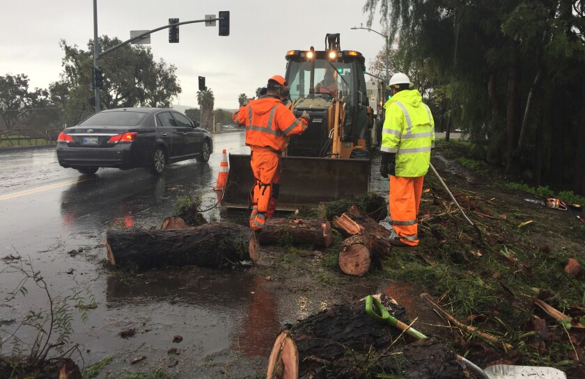 San Diego County workers removed fallen trees in January on Bonita Road.