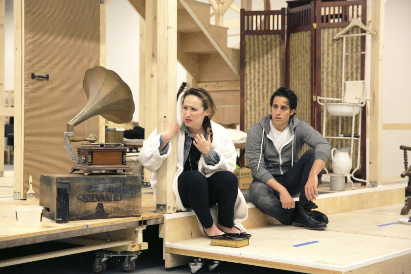 """Eden Espinosa and Jared Zirilli rehearse a scene from the musical """"Rain,"""" which is having its world premiere at the Old Globe Theatre in Balboa Park."""