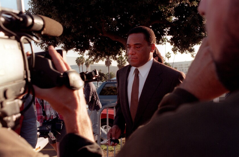A.C. Cowlings is trailed by the media as he leaves court on Dec. 3, 1996, after testifying in the wrongful death civil suit against O.J. Simpson.