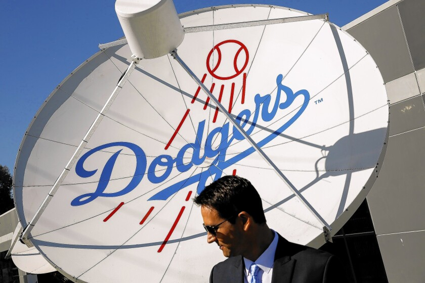 The Dodgers charged $8 billion for broadcast rights to their games, knowing full well that pay-TV companies would have to pass along this sky-high cost to all customers. Above, John Hartung, the studio anchor for SportsNet L.A.