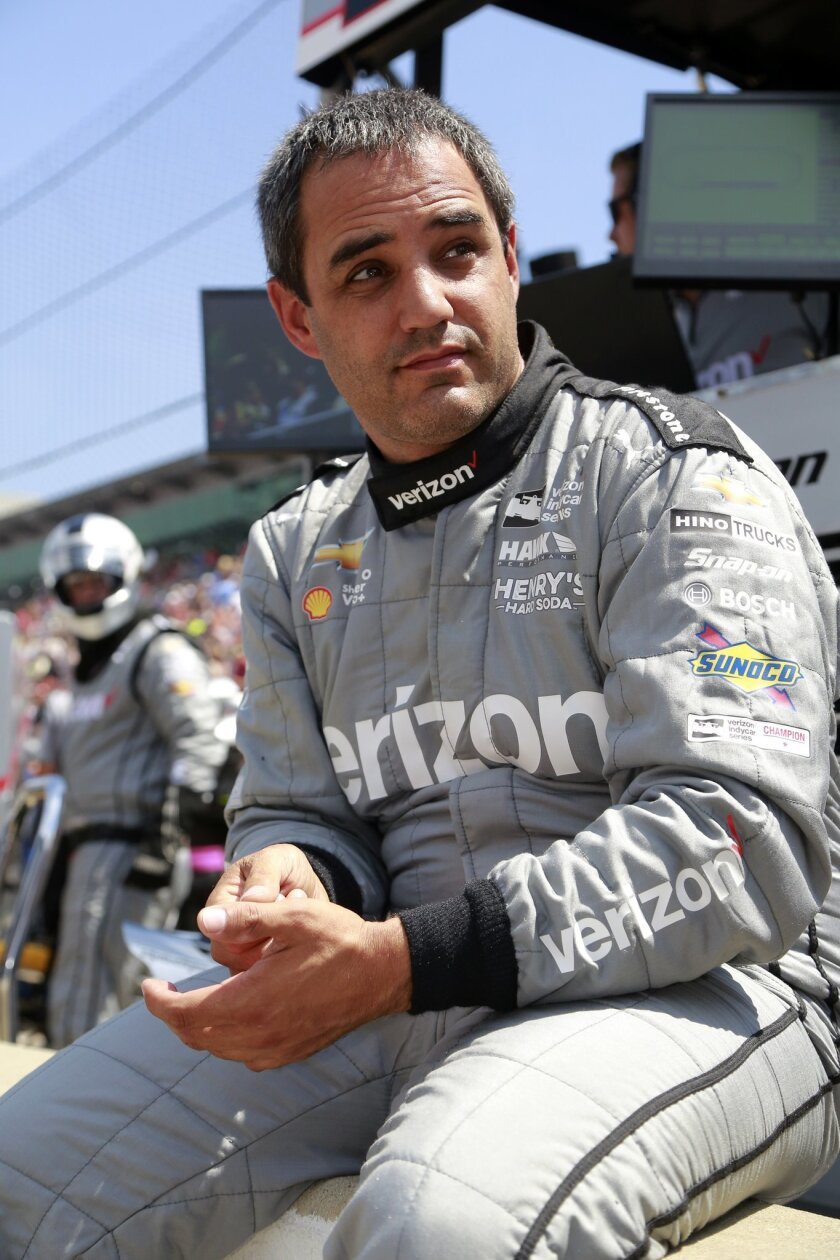 Juan Pablo Montoya, of Colombia, sits in the pit area during the final practice session for the Indianapolis 500 auto race at Indianapolis Motor Speedway in Indianapolis, Friday, May 27, 2016. (AP Photo/R Brent Smith)