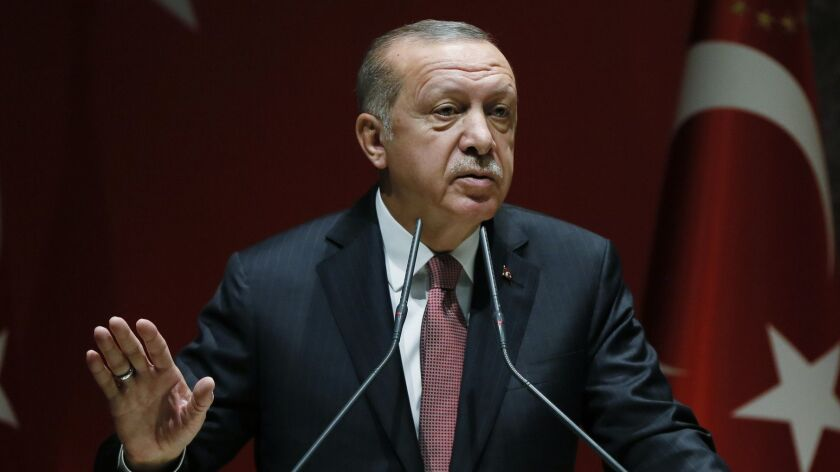 Turkey's President Recep Tayyip Erdogan talks to members of his ruling Justice and Development Party