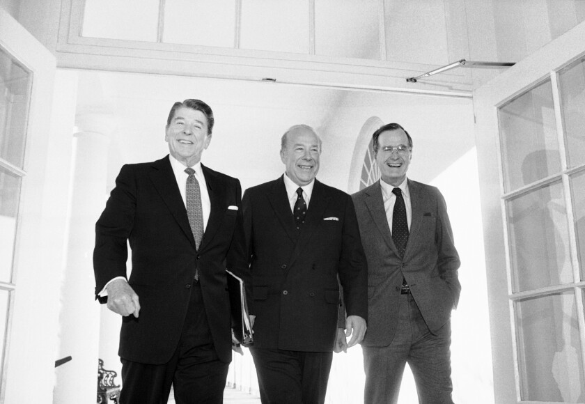 Secretary of State George P. Shultz, center, with President Ronald Reagan and Vice President George H.W. Bush in 1985.