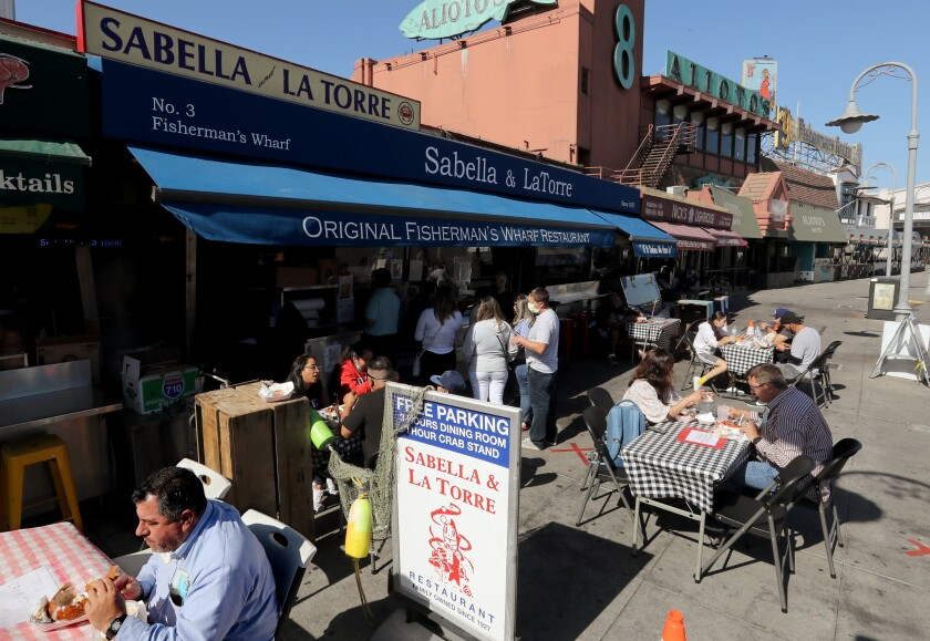Customers dine in outdoor eating areas at Fishermen's Wharf in San Francisco.