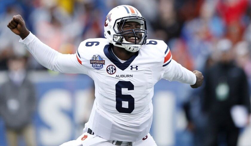 Auburn's Jeremy Johnson celebrates after passing for an 11-yard touchdown against Memphis in the third quarter of the Birmingham Bowl on Wednesday.
