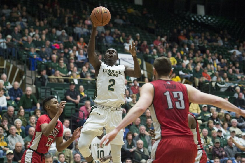 FILE - In this Jan. 6, 2016 file photo, Colorado State's Emmanuel Omogbo shoots against UNLV during an NCAA college basketball game in Fort Collins, Colo. Omogbo gave Colorado State an emotional lift in an 83-79 win over Air Force on Wednesday, Jan. 20, a day after losing his parents and two young relatives in a house fire. Fire officials in Maryland said Caroline and Samson Omogbo died at the scene in a blaze early Tuesday in Chillum. His sister's 2-year-old twins were taken to a hospital, where they died. (Austin Humphreys/The Coloradoan via AP)