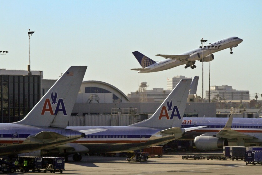 "American Airlines said it has grounded its domestic fleet of airplanes because of computer problems. The airline said planes will remain grounded until 2 p.m. PDT as it ""works to resolve this issue."""