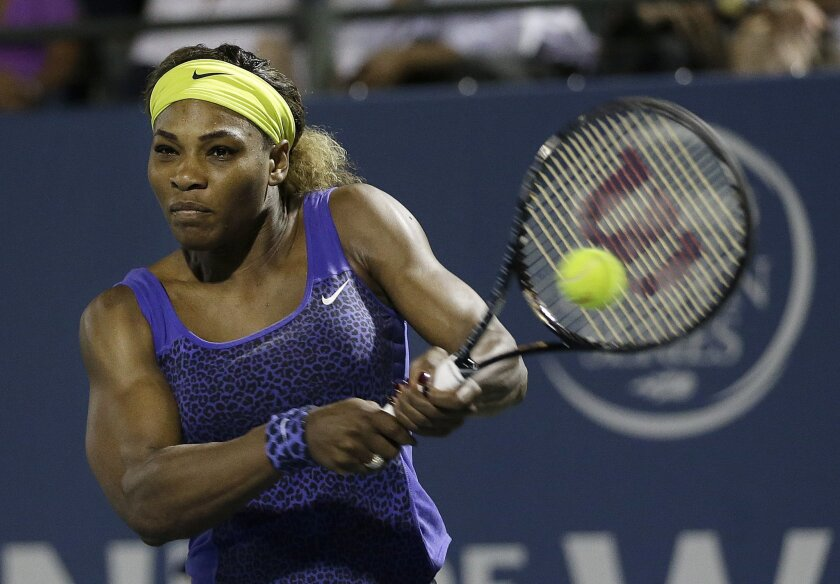 Serena Williams returns the ball to Ana Ivanovic, from Serbia, during the second set of their match in the Bank of the West Classic tennis tournament in Stanford, Calif., Friday, Aug. 1, 2014. Williams won 2-6, 6-3, 7-5. (AP Photo/Jeff Chiu)