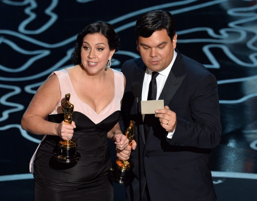 "Songwriters Kristen Anderson-Lopez and Robert Lopez accept the original song award for ""Let It Go"" from ""Frozen."""