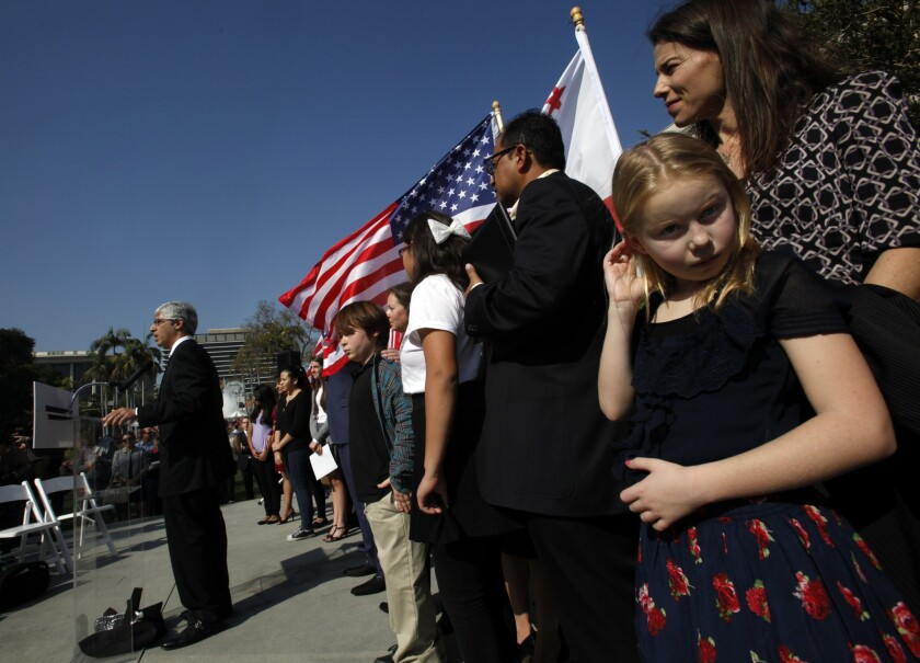 Plaintiff Clara Campbell, 9, adjusts her hair as she listens to attorney Theodore Boutrous speak about a lawsuit to overturn laws that provide seniority protections to California teachers. At the trial's end, both sides asserted that students' interests are at stake.