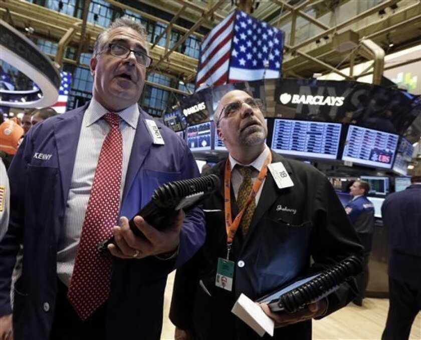 Traders Kenneth Polcari, left, and John Liotti work on the floor of the New York Stock Exchange, Friday, April 12, 2013. The stock market is heading lower in early trading after a four-day rise as bank shares weaken. (AP Photo/Richard Drew)