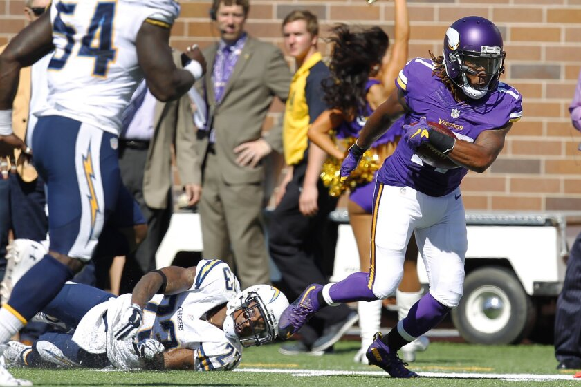 Vikings Jarius Wright gets by Chargers Steve Williams in the 2nd quarter.